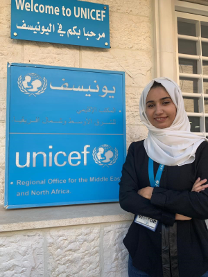 Nosaiba Othman in front of the UNICEF MENARO office
